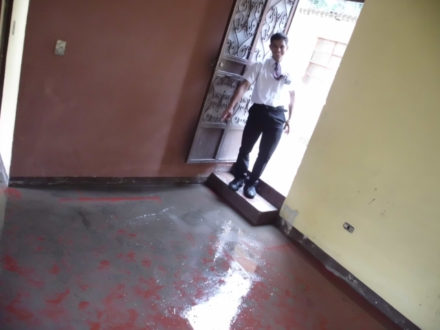 Here is a photo of Elder Brito and our new flooded house =) We got there and EVERYTHING was soaked. We spent the whole day, (the ZLs too, awesome of them) cleaning and drying.